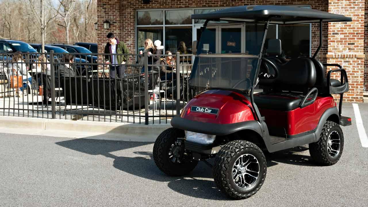 metallic-red-4-passenger-lifted-golf-cart
